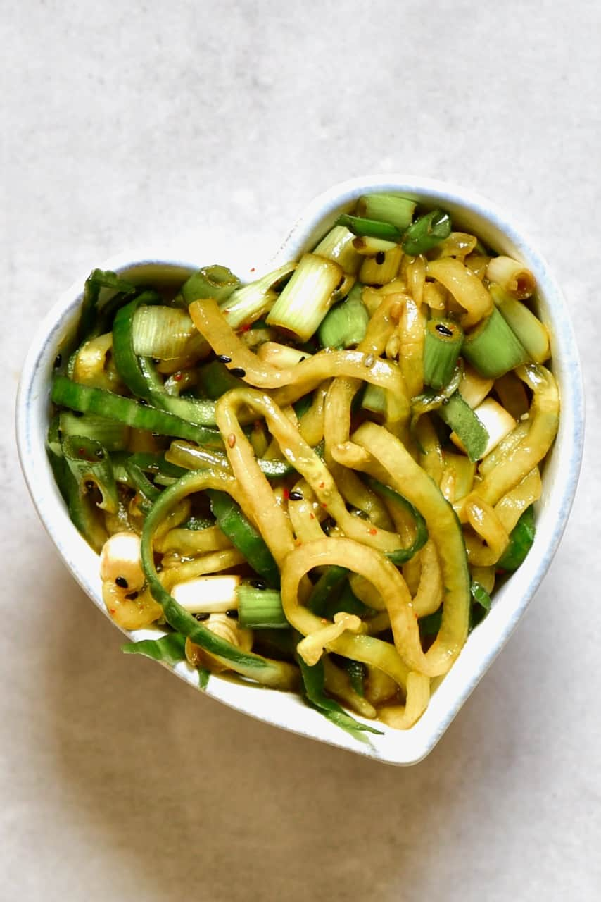asian cucumber salad in a heart shaped bowl