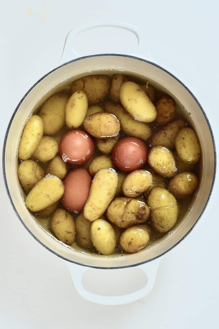 boiled eggs and potatoes in a large pot