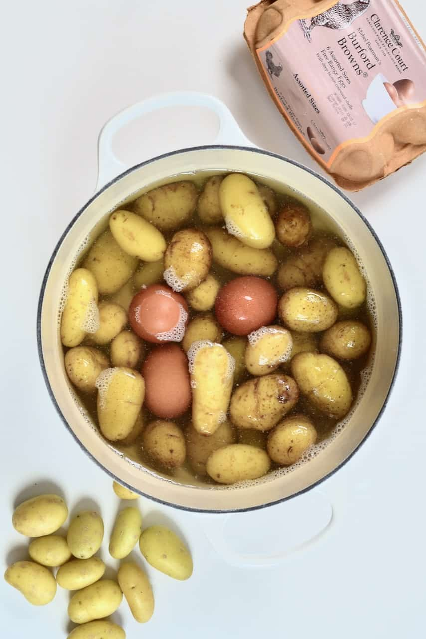 boiled potatoes and eggs in a pot