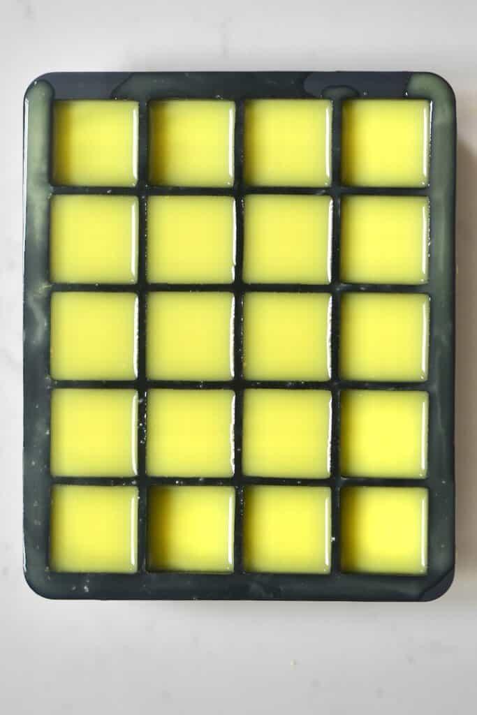 fresh ginger juice inside a black ice cube tray