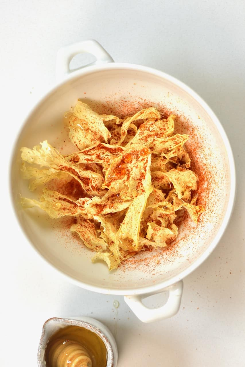 ginger chips sprinkled with cayenne pepper and honey