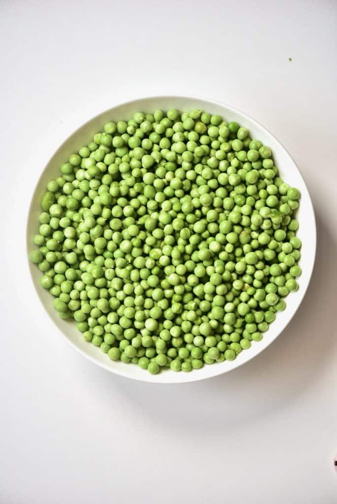green peas inside a round shaped bowl