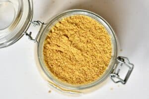 ground Golden Flaxseed in a glass container