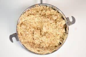 ground almonds inside a grinder