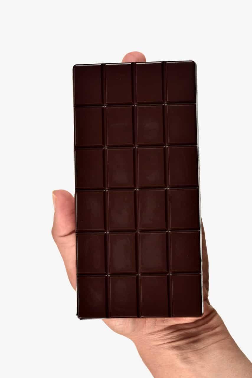holding homemade dark chocolate bar