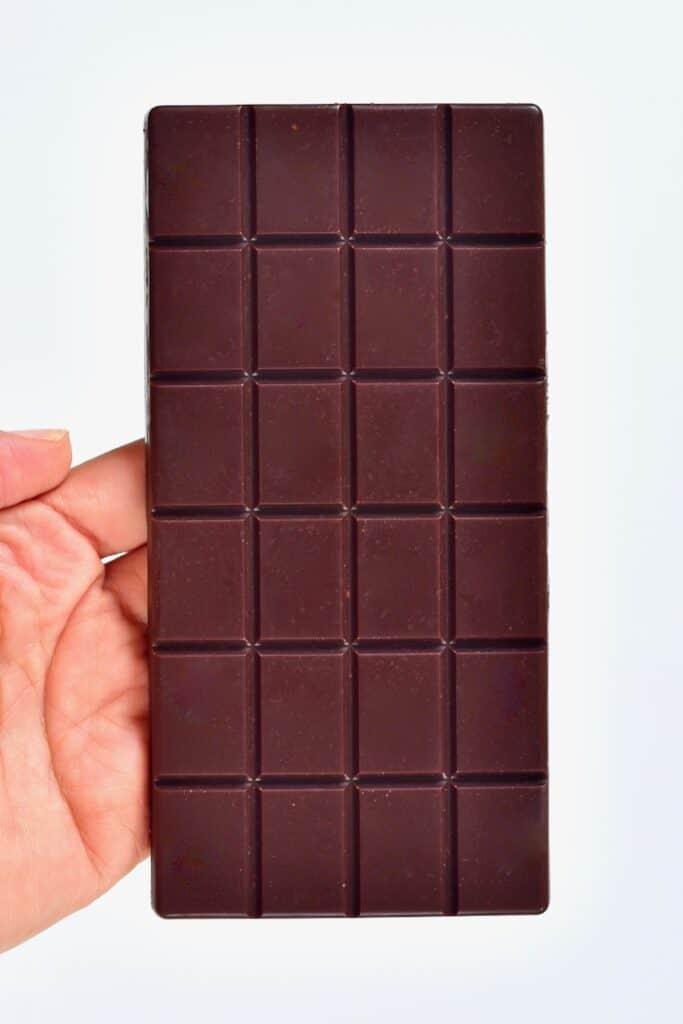 holding homemade milk chocolate bar