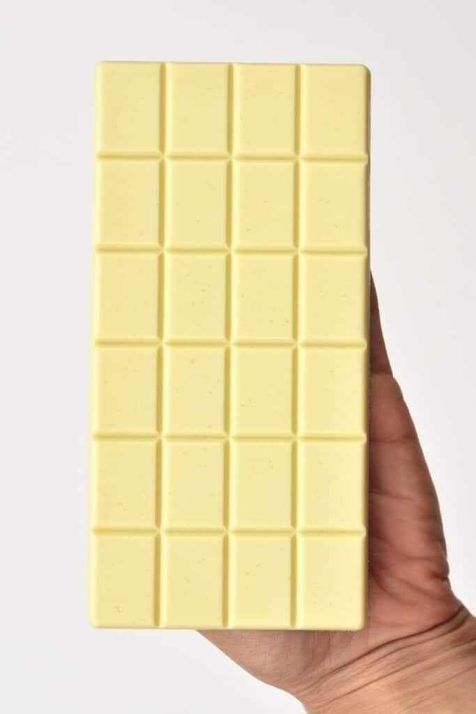 holding white chocolate bar