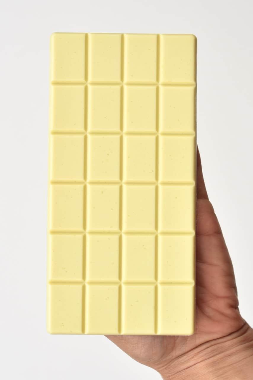holding white chocolate bar