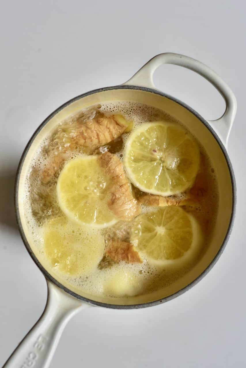 boiling lemon and ginger tea in pot