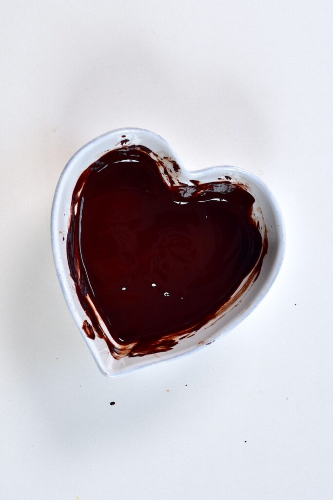 melted Milk Chocolate in a heart shaped bowl