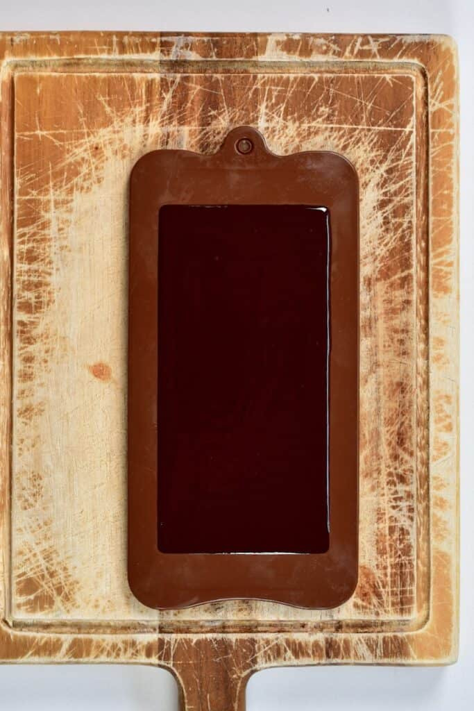 melted Milk Chocolate inside a chocolate mold