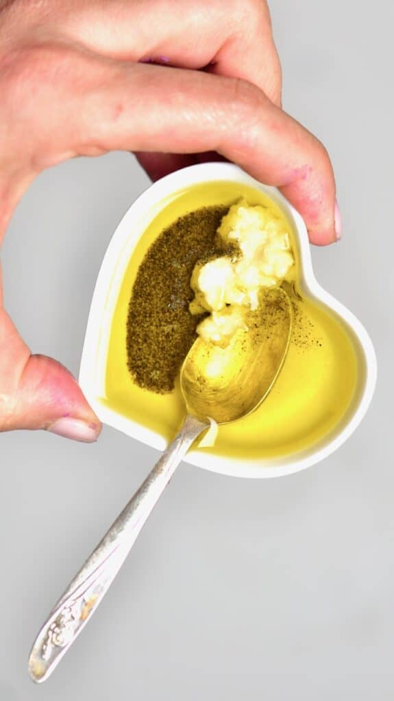 olive oil galric and black pepper in small heart shaped bowl