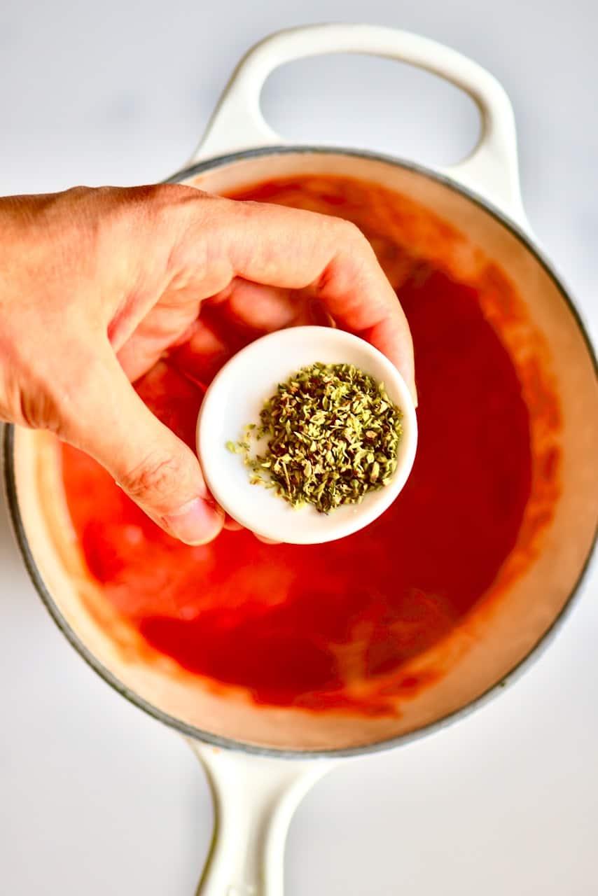 oregano and a tomato marinara sauce