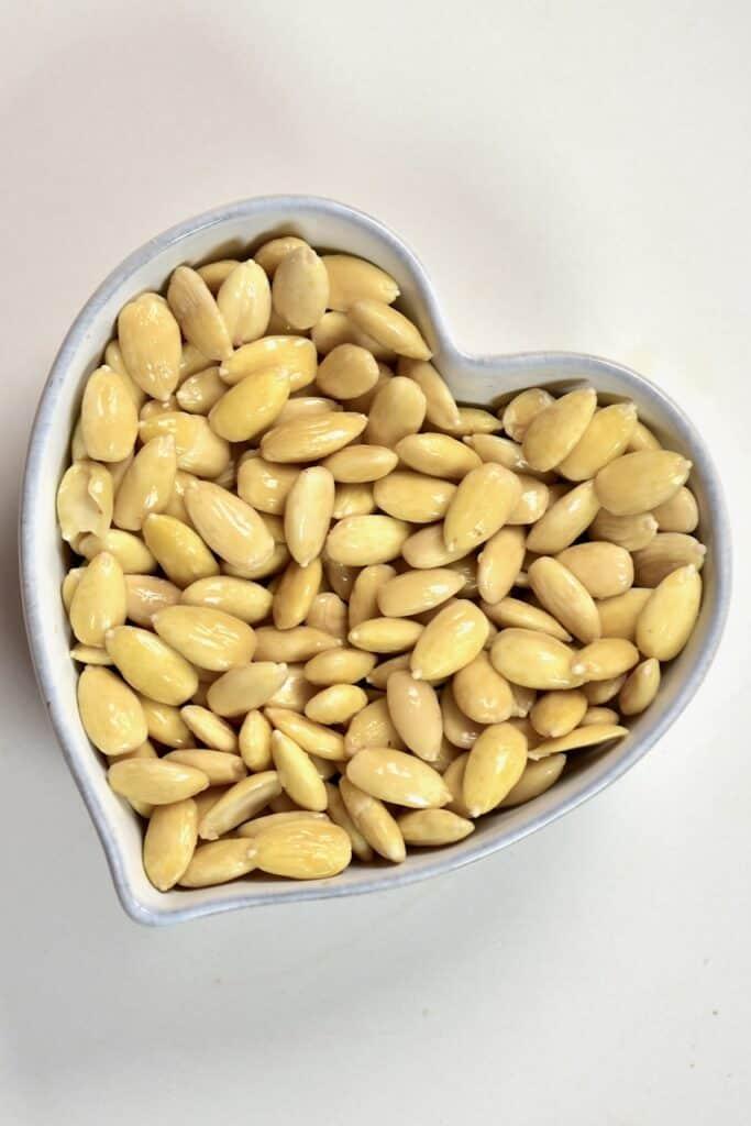 peeled almonds insdie a heart shaped bowl.jpeg