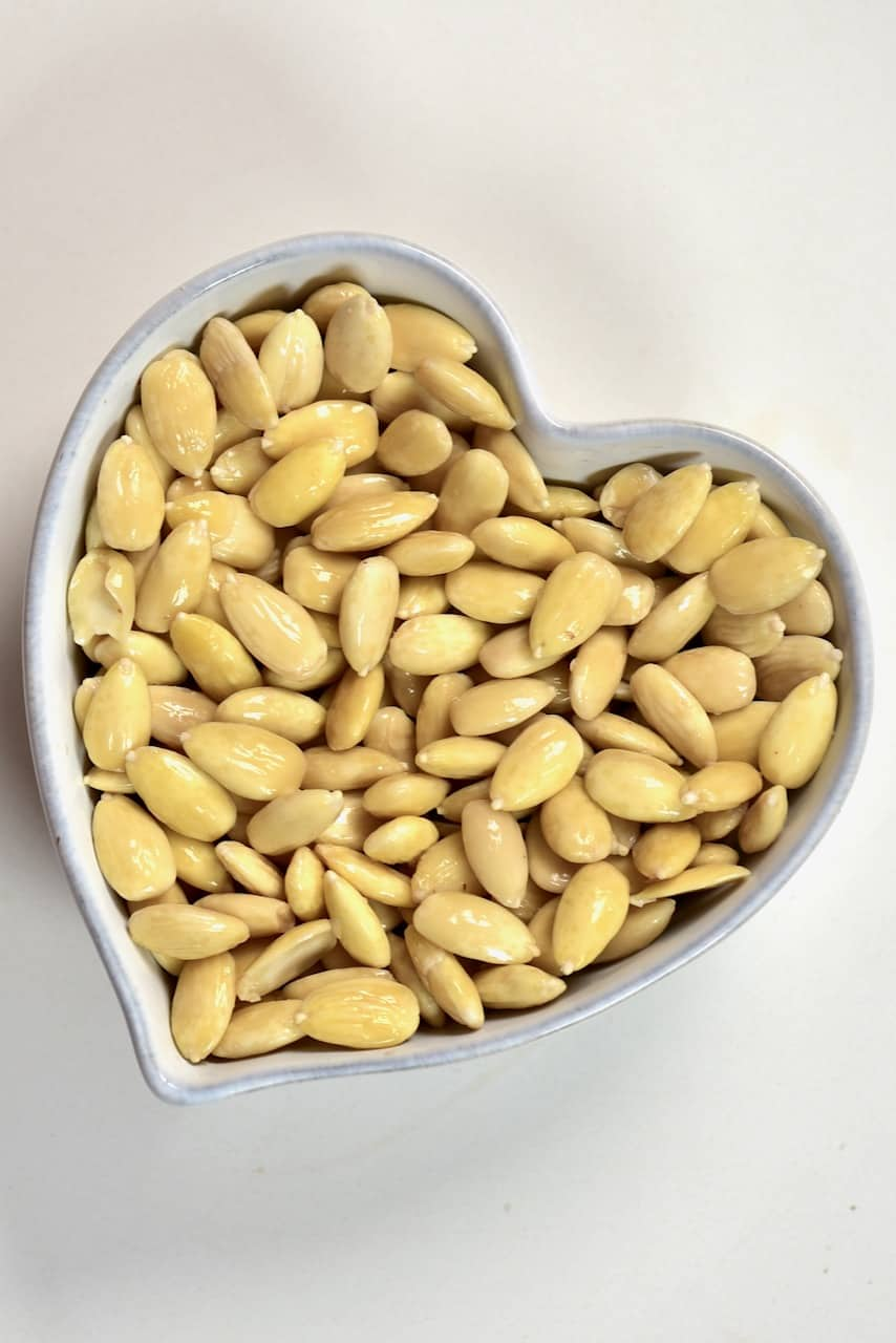 peeled almonds insdie a heart shaped bowl.jpeg