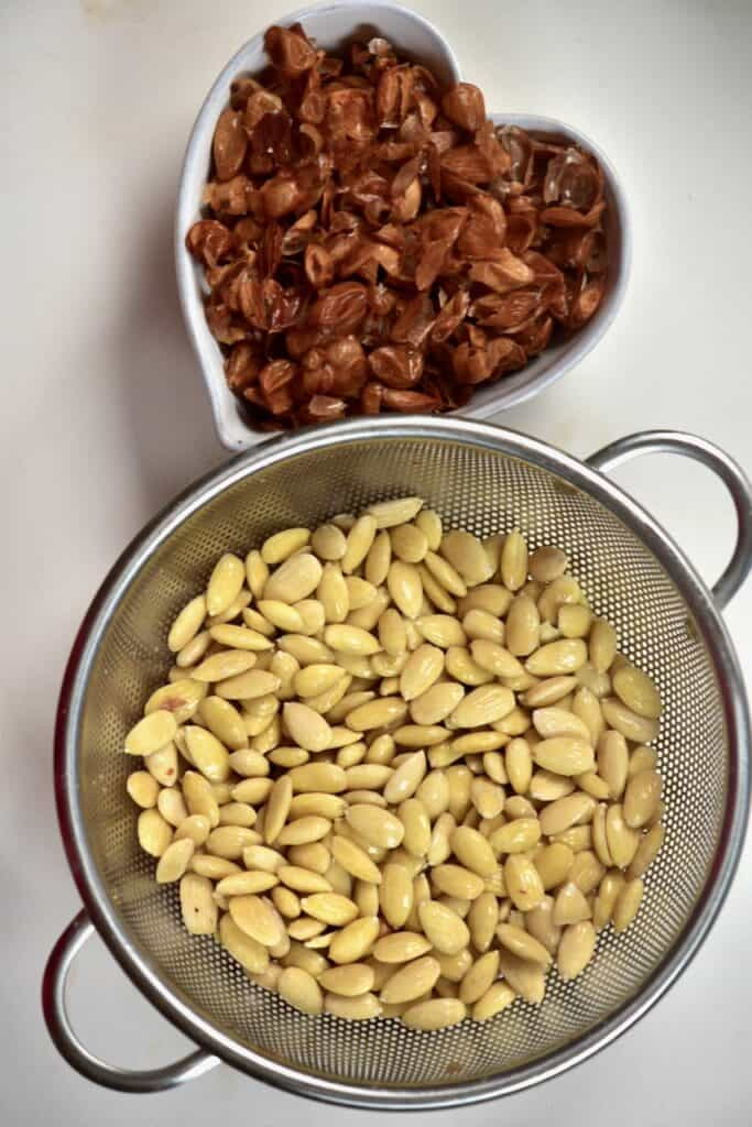 seperating peeled almonds and almond skin