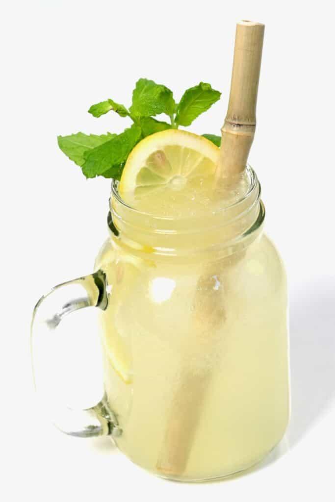 side view fresh lemonade in mason jar
