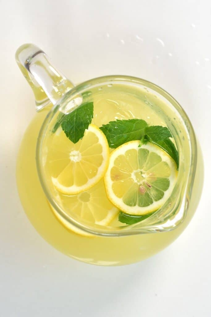 top view lemonade jug with lemon and mint slices