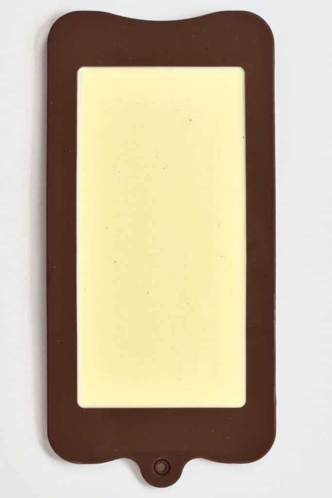 white milk chocolate set in a mold