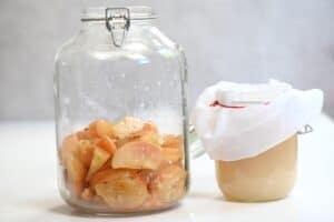 Leftover apples in a jar after transferring homemade apple cider vinegar