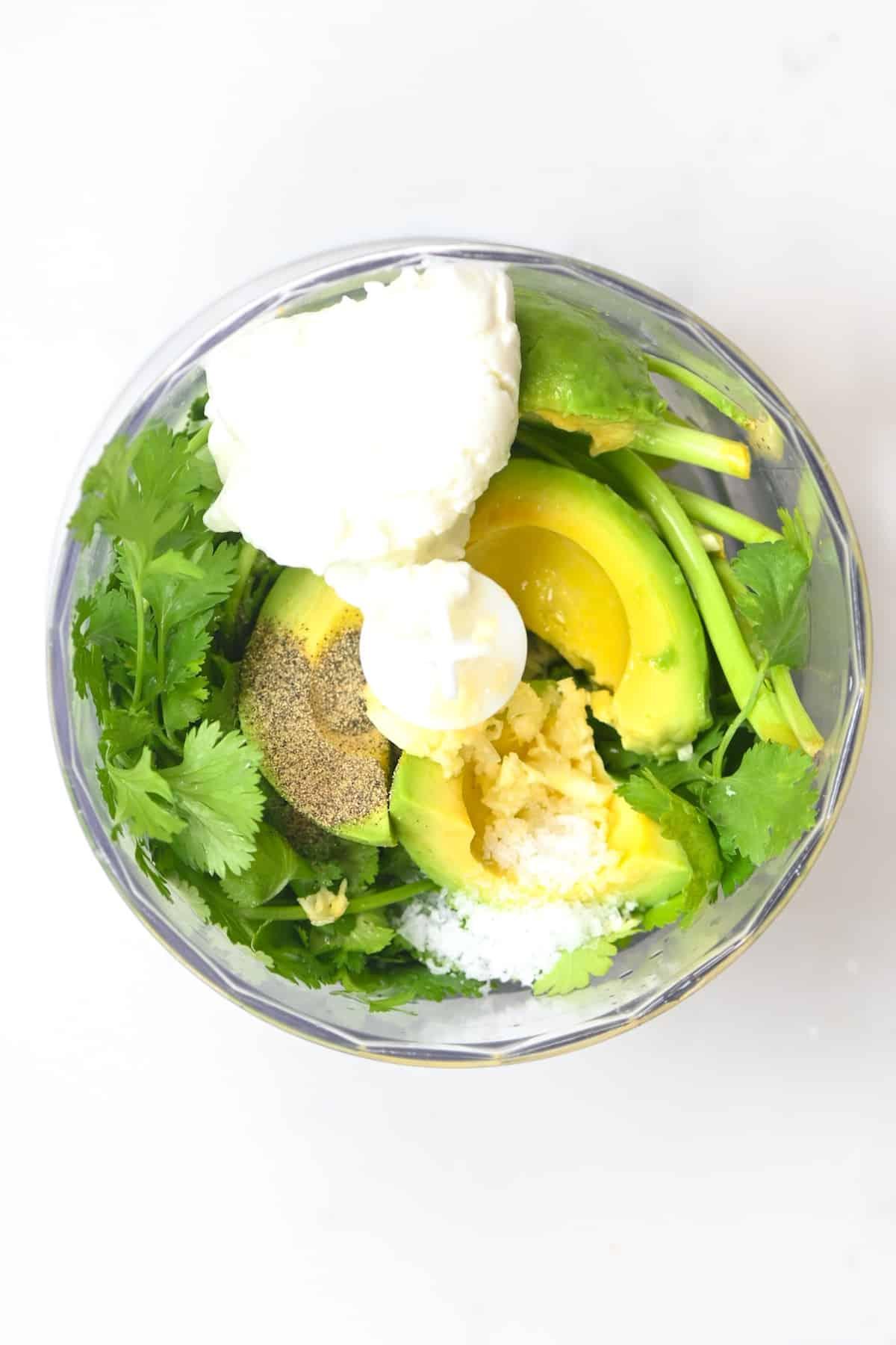 processing the ingredients for Creamy Avocado Cilantro Sauce
