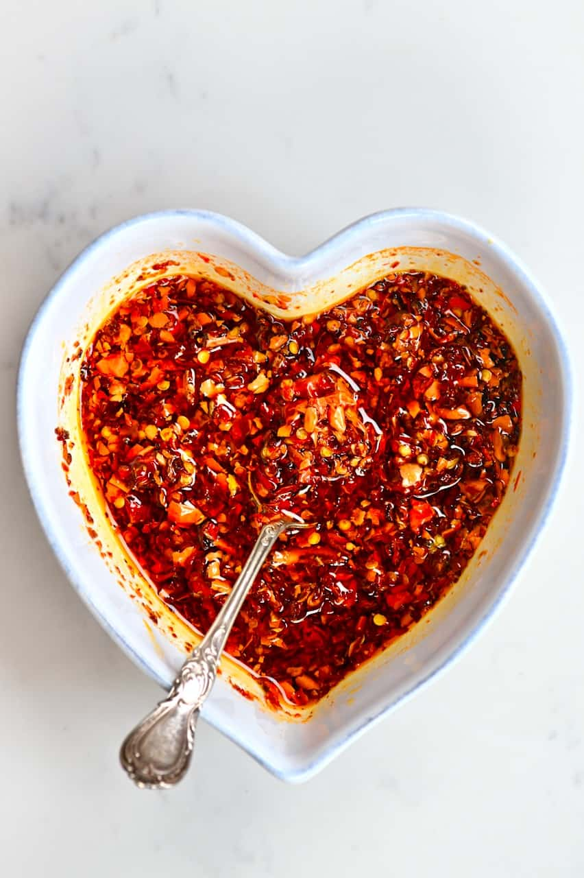 Chilli Oil in a heart shaped bowl with a spoon