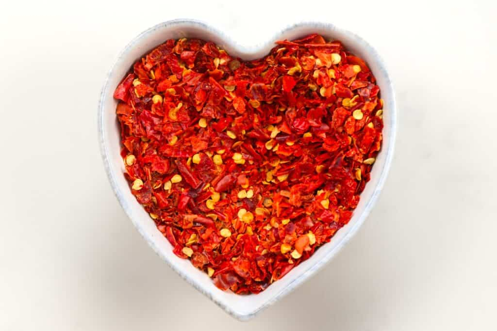 Chilli flakes in a heart shaped bowl