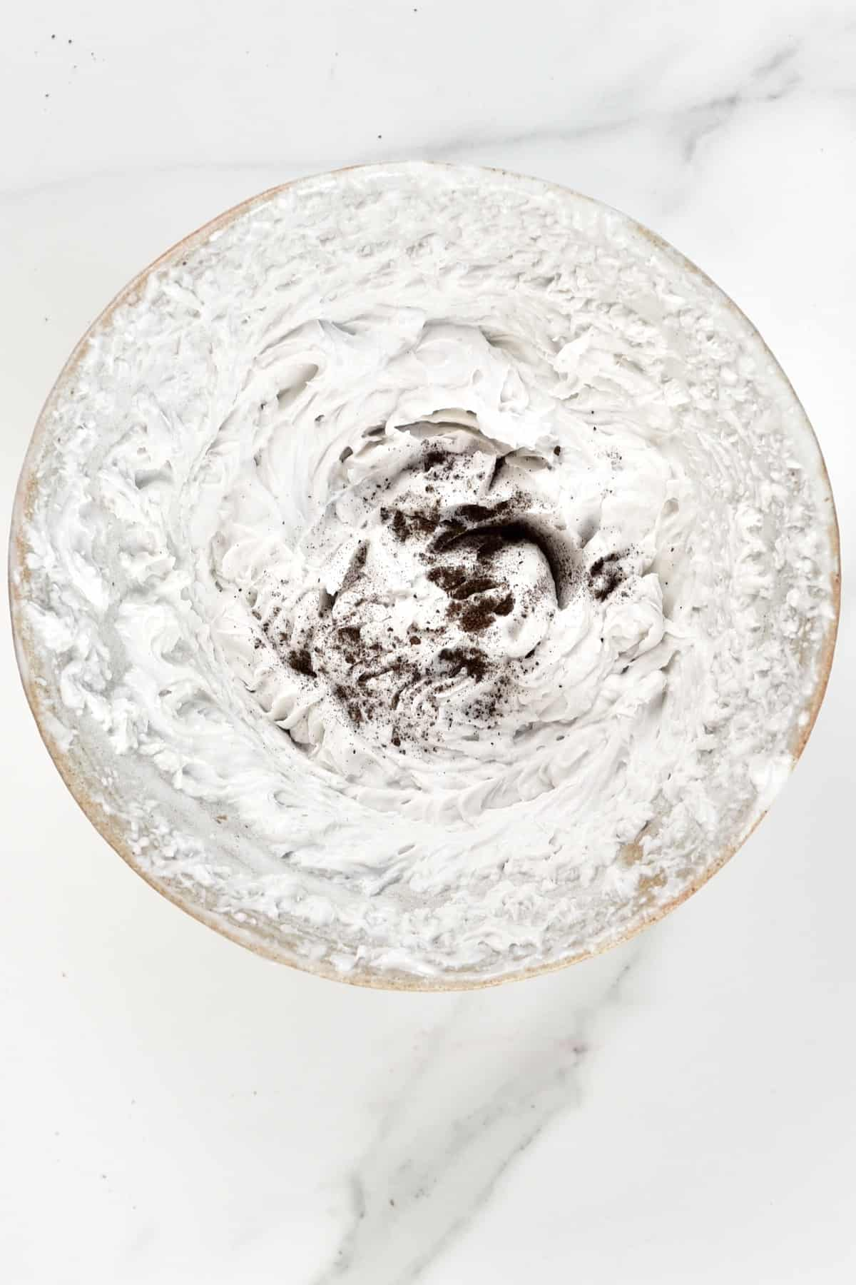 Whipped coconut cream sprinkled with vanilla powder