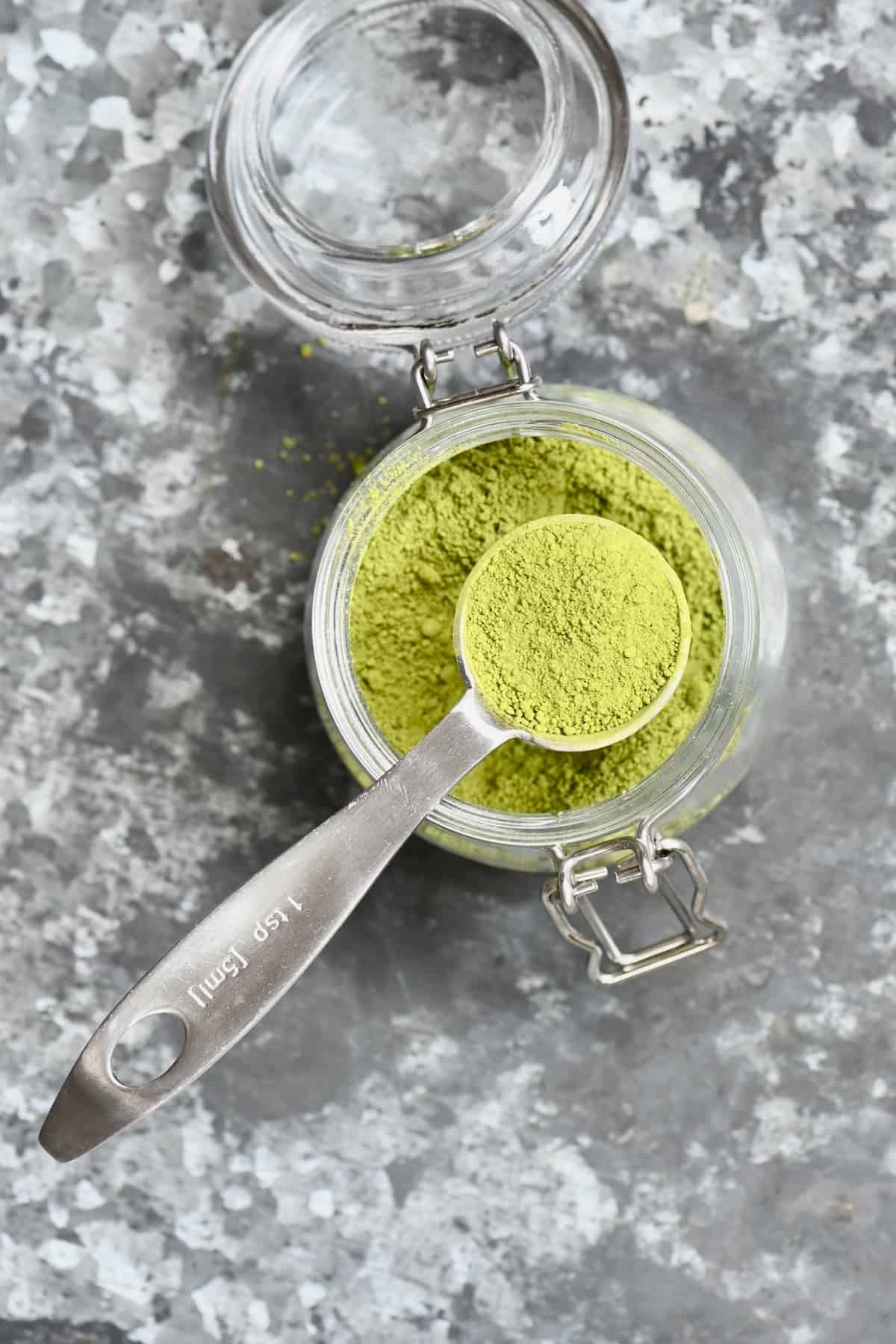 Teaspoon of matcha over a jar