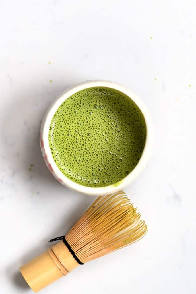 Whisked matcha and a bamboo whisker
