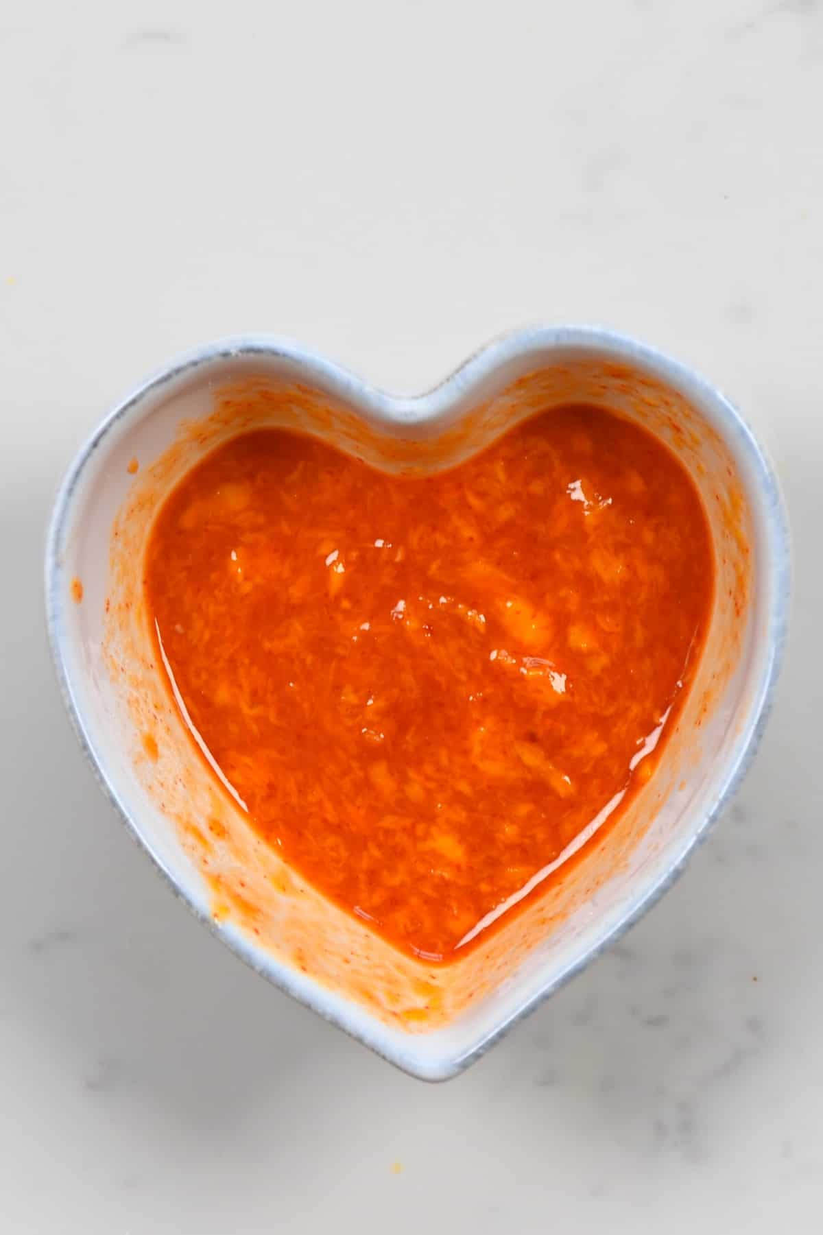 Mango Sweet Chili Dipping Sauce in a heart shaped bowl
