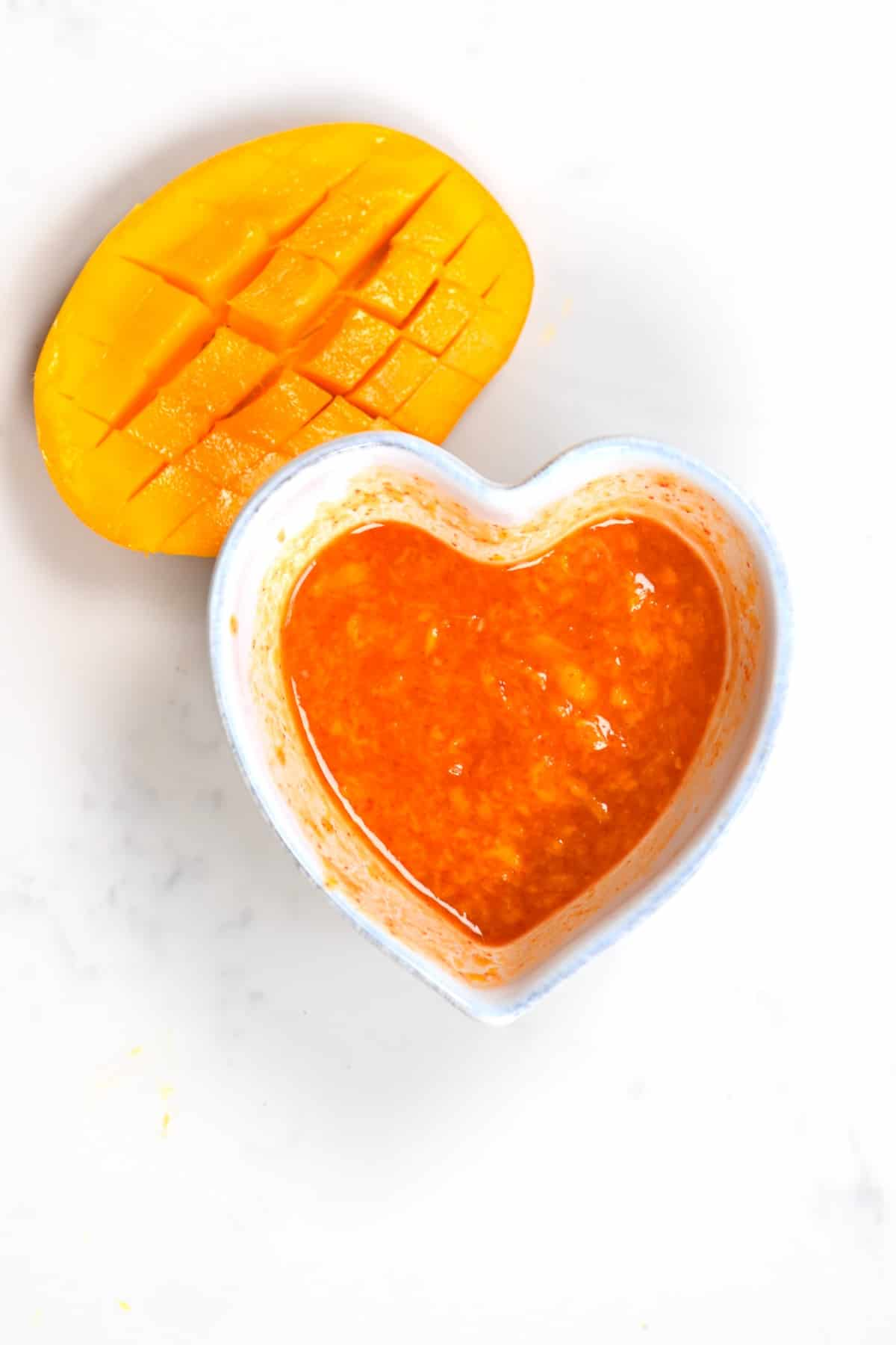 Mango Sweet Chili Dipping Sauce and a mango cut in half