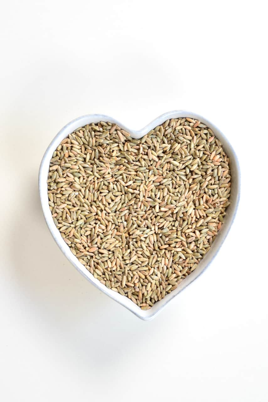 Rye grain in a heart shaped bowl