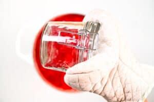 Sterilized hot jars to store strawberry jam