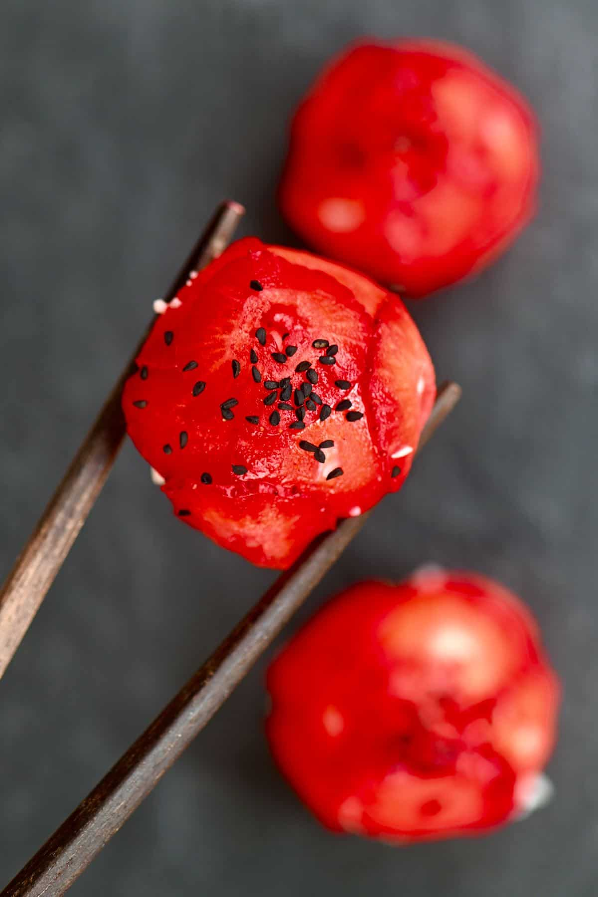 Strawberry sushi ball with a sprinkle of nigella seeds