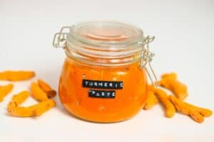 Turmeric Paste jar and turmeric root