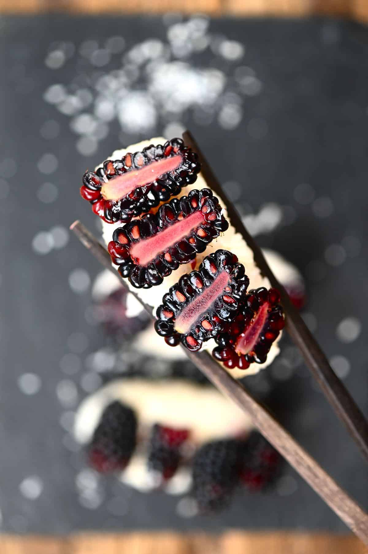 closeup of blackberry sushi