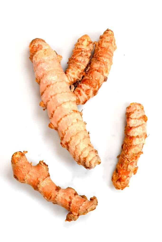 three fresh turmeric roots