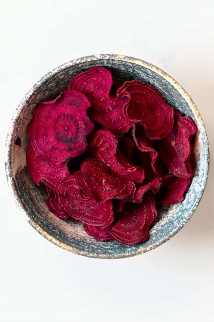 Homemade beetroot chips in a bowl