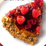 A slice of Raspberry Granola Pizza in a white plate