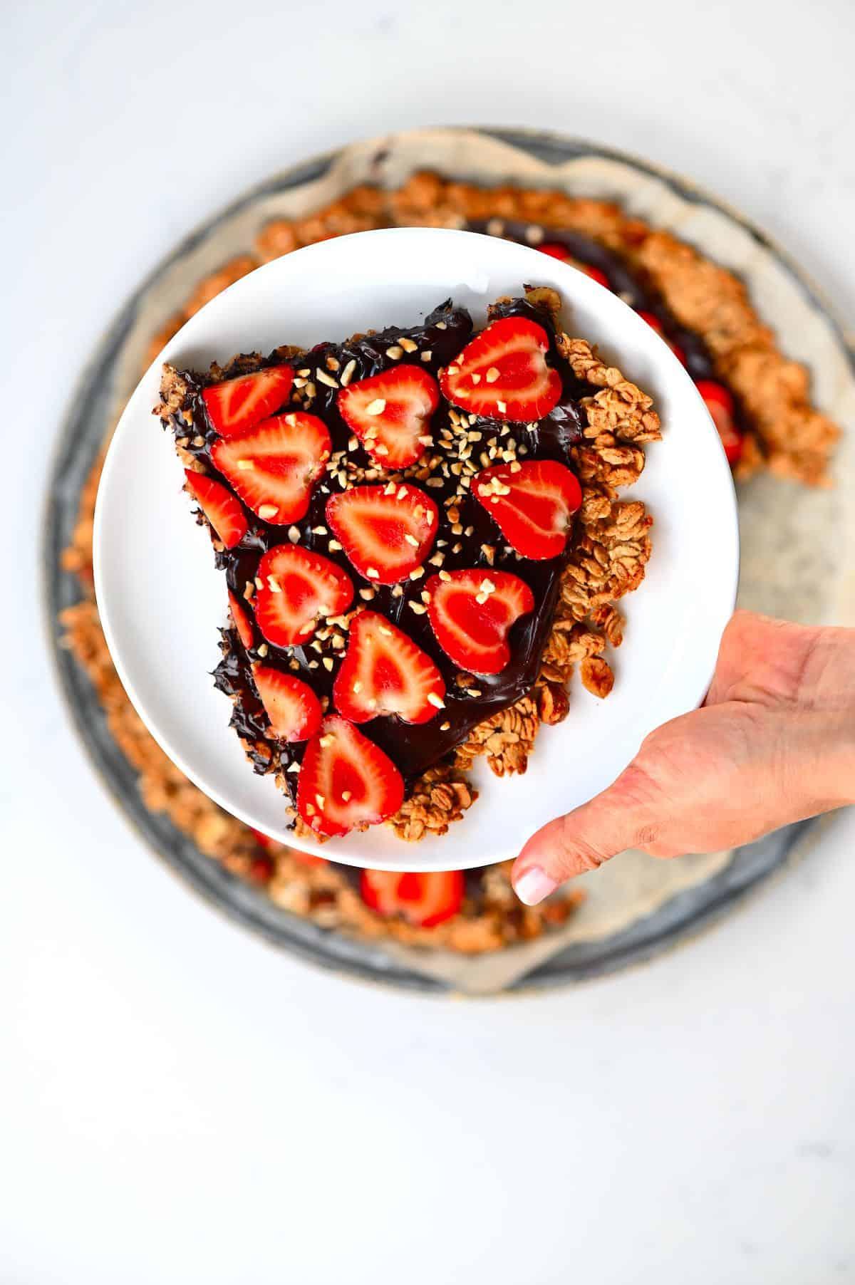 Strawberry Nutella Pizza slice on a white plate