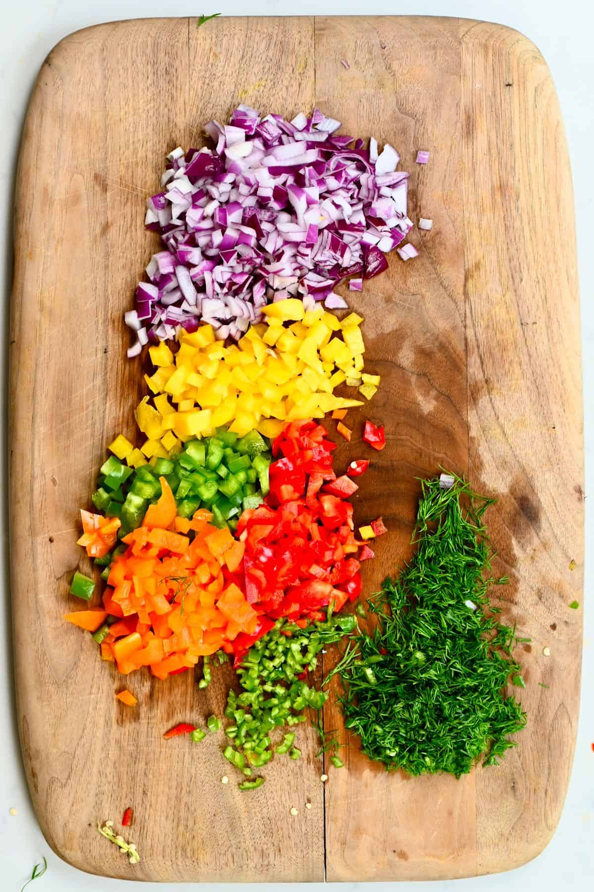 chopped veggies on a wooden board