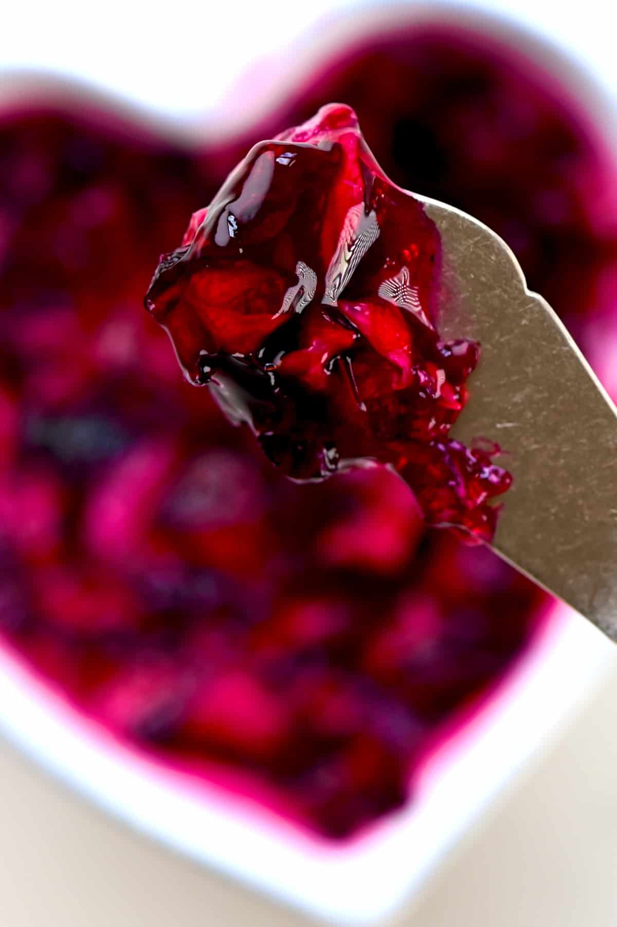 close up of Rose Jam on a butter knife