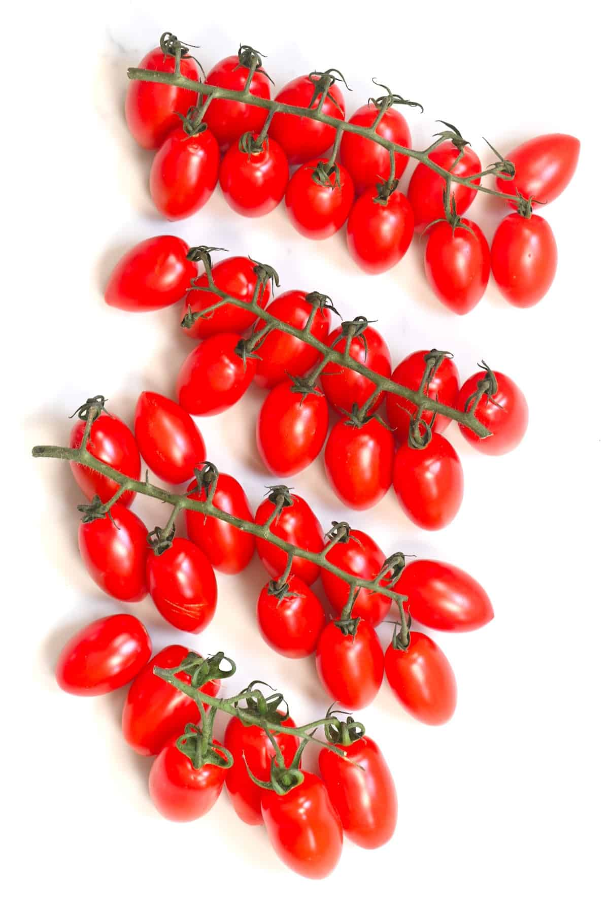 Cherry tomatoes on a white surface