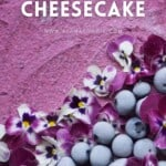 A close up of Blueberry Earl Grey Cheesecake decorated with edible flowers and frozen berries