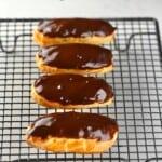 Four chocolate glazed eclairs