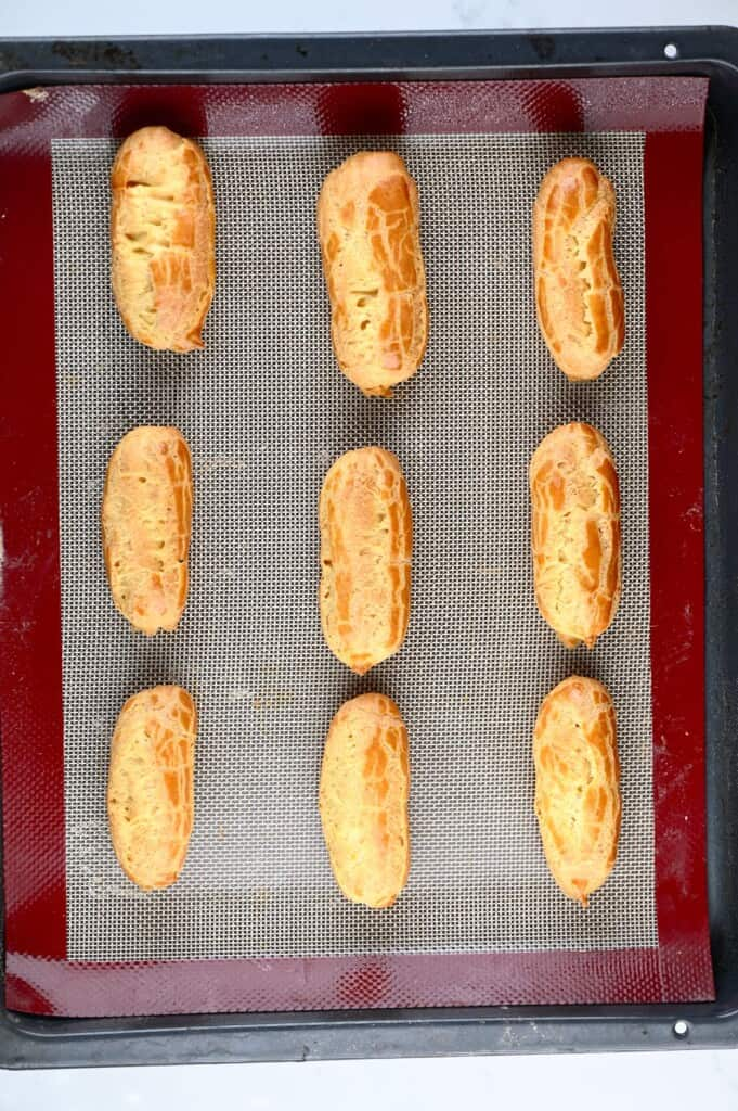 Baked choux pastry in the shape of eclairs