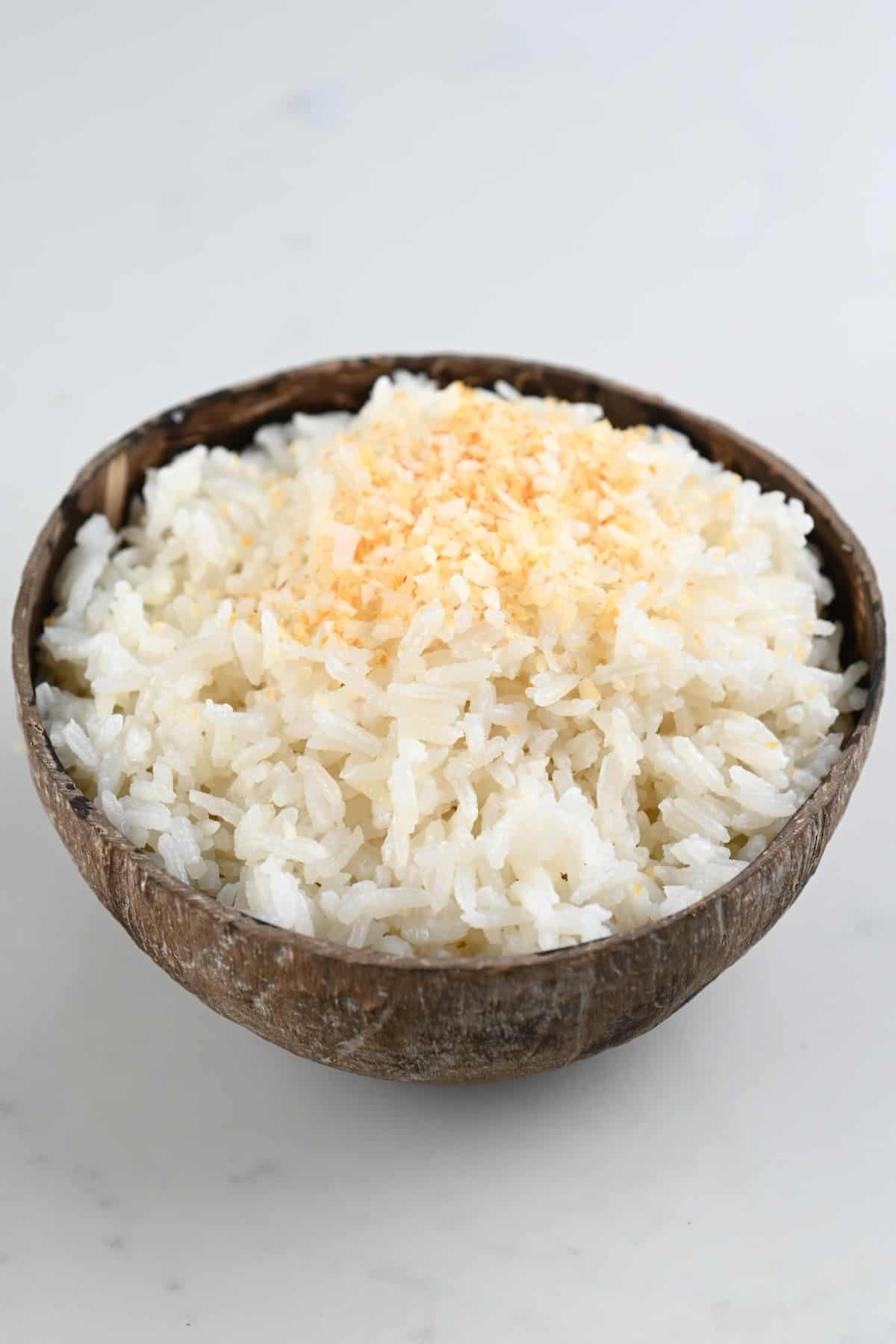 Coconut rice served in a coconut bowl