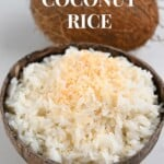 Coconut rice served in a coconut shell with a whole coconut behind it