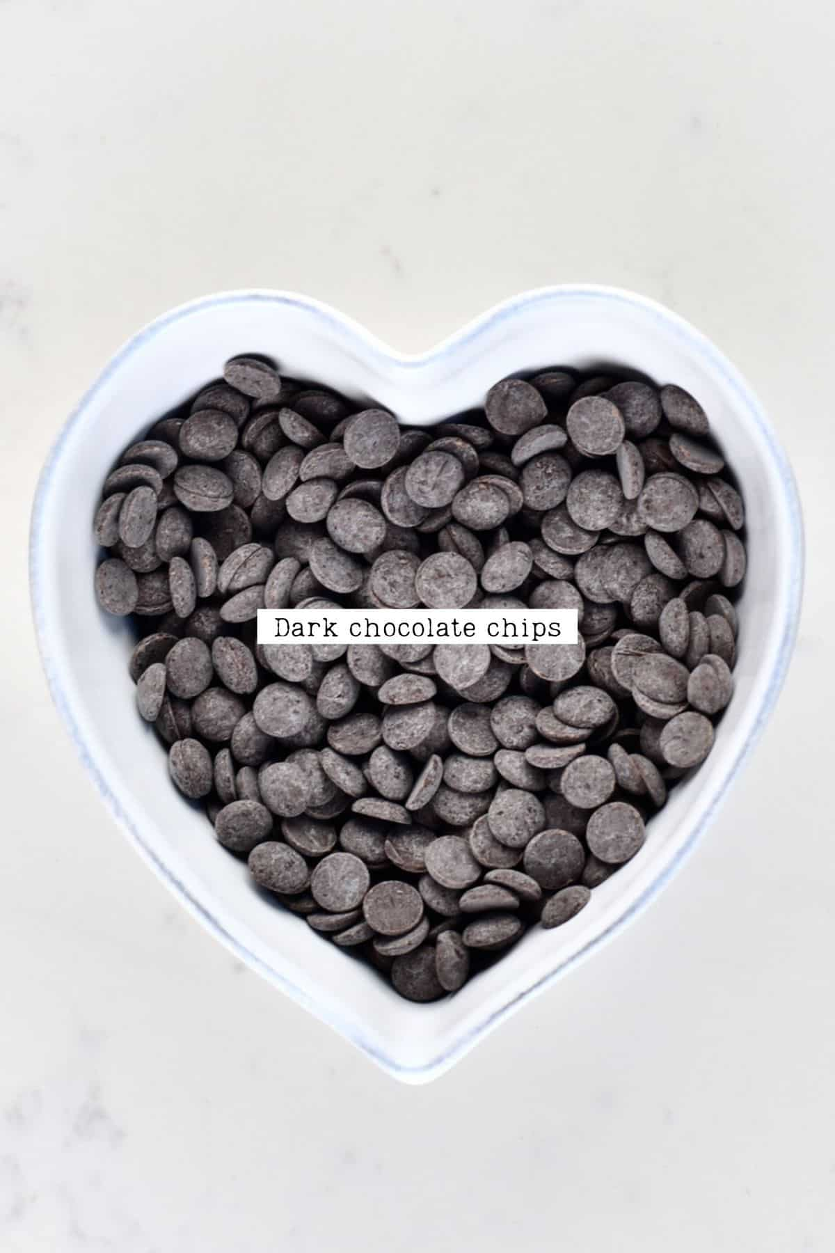 Dark chocolate chips in a heart shaped bowl